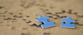 Two Blur Puzzle Pieces laying flat on puzzle background