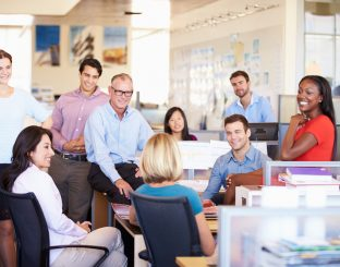 Businesspeople Having Meeting In Modern Open Plan Office